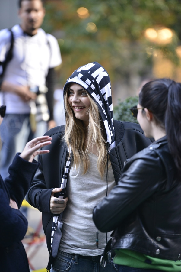 Cara Delevingne at a photoshoot for Donna Karan's mainline fashion label, DKNY, in New York City on October 15, 2013