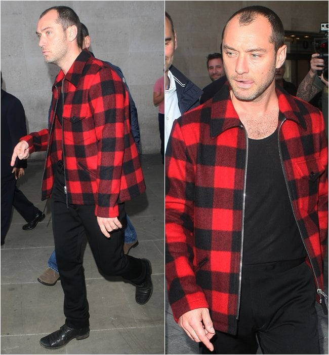 Jude Law sported the tartan trend while posing and signing autographs for his fans