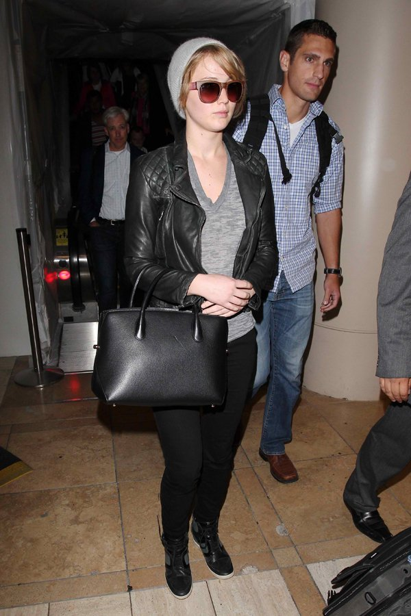 Jennifer Lawrence looked tired after a long flight, but she was definitely not lacking in the style department