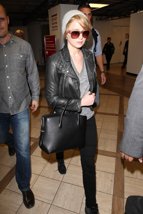 Jennifer Lawrence rocked a leather jacket from AllSaints with black denim pants, Adidas Y-3 Sukita high-top sneakers, and a plain gray shirt