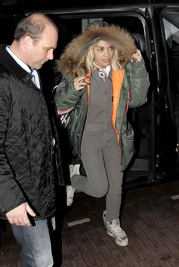 Rita Ora wearing a thick parka jacket