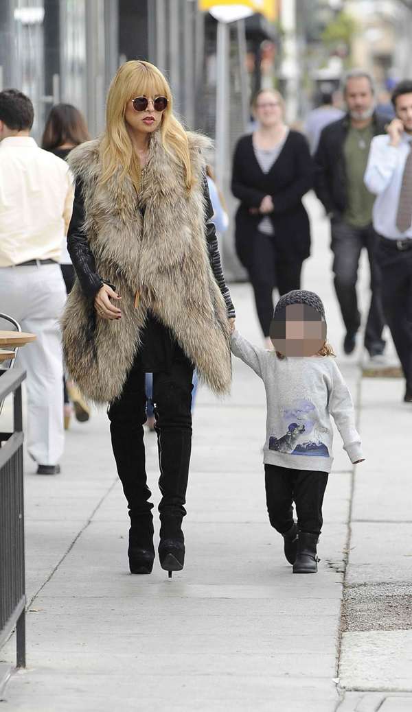 Heavily pregnant Rachel Zoe keeping warm in an oversized sleeveless fur coat, taking son Skyler to Froyo Life for a frozen yogurt in Los Angeles on November 20, 2013
