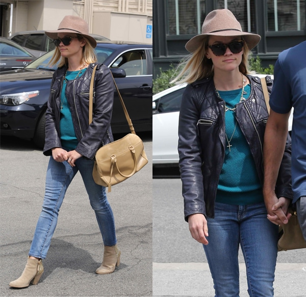 Reese Witherspoon wears a leather jacket with jeans