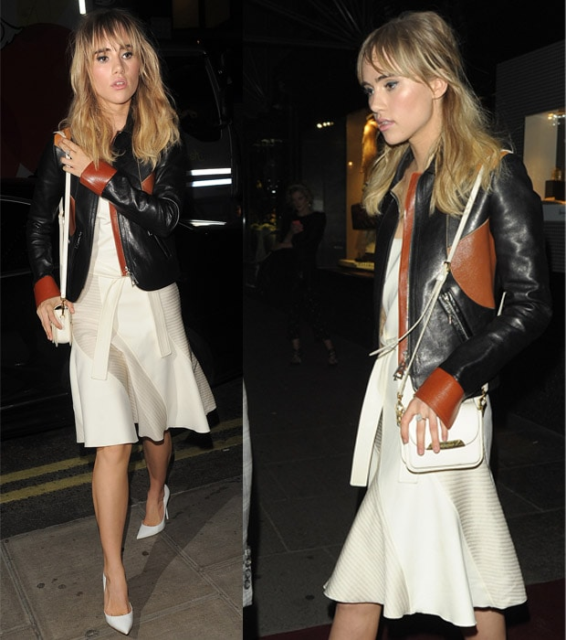 Suki Waterhouse shows how to wear a white dress with a black leather jacket in London