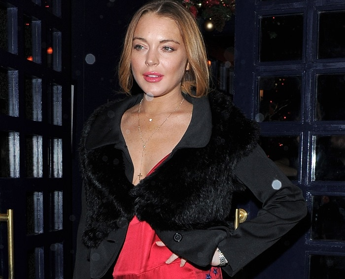 Lindsay Lohan sported a red star-embroidered lace and satin jumpsuit by Matthew Williamson paired with a black furry Marin jacket