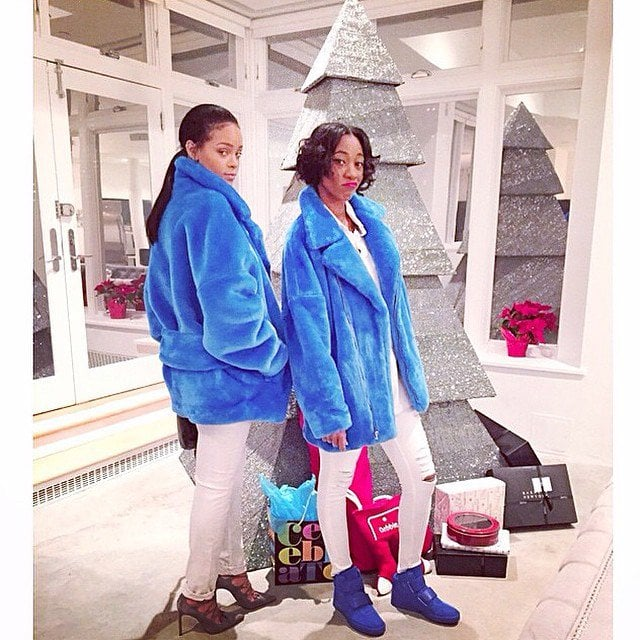 Rihanna and Melissa Forde wearing blue furry coats