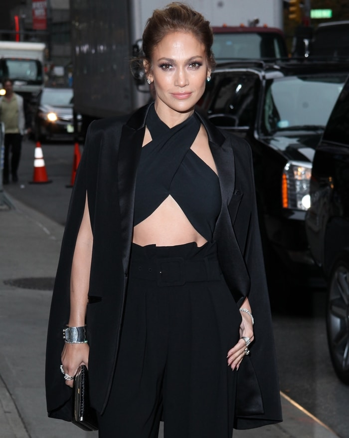 Jennifer Lopez styled a cut-out crop top with a tuxedo-style cape