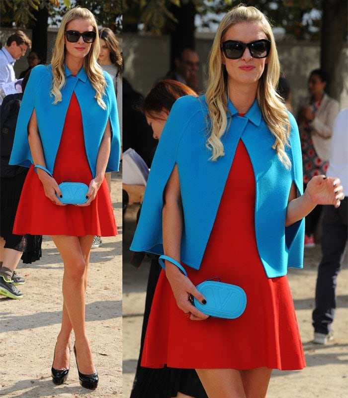 Nicky Hilton flaunted her legs in a red dress with a Valentino blue cropped wool-cashmere cape