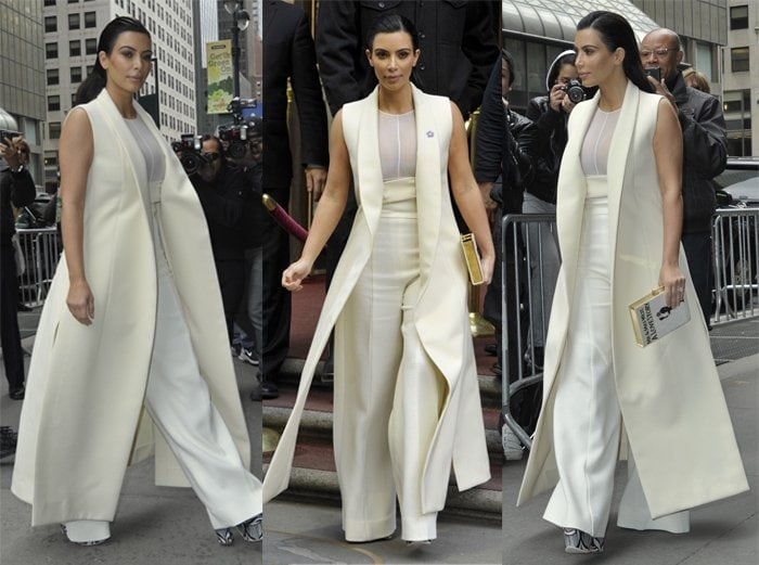 Kim Kardashian in an almost floor-length Narcisco Rodriguez Fall 2015 sleeveless coat with a sheer top and high-waisted, wide-legged trousers