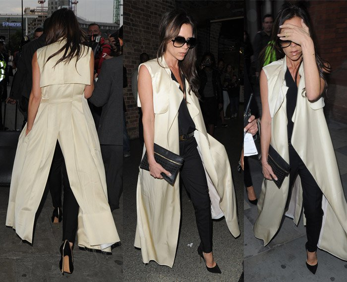 Victoria Beckham wearing tapered pants, cleavage-baring top and a coat from Saint Laurent