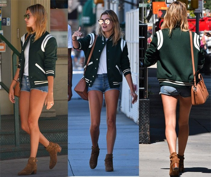 Hailey Baldwin flaunts her legs in Armani denim shorts and a white top