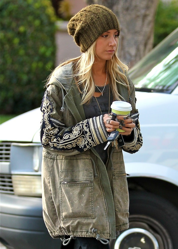 Ashley Tisdale wears an oversized forest green toque while grabbing a coffee from Urth Caffé