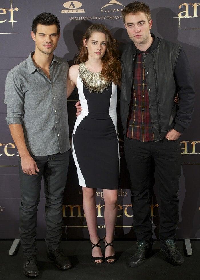 Taylor Lautner, Kristen Stewart, and Robert Pattinson at The Twilight Saga: Breaking Dawn — Part 2 photo call at Villamagna Hotel in Madrid on November 15, 2012