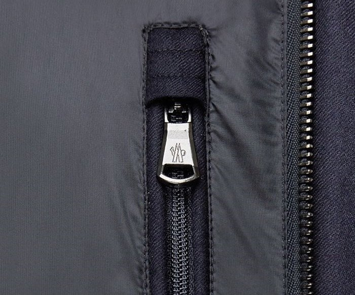 Inspect the Moncler zippers and buttons very closely