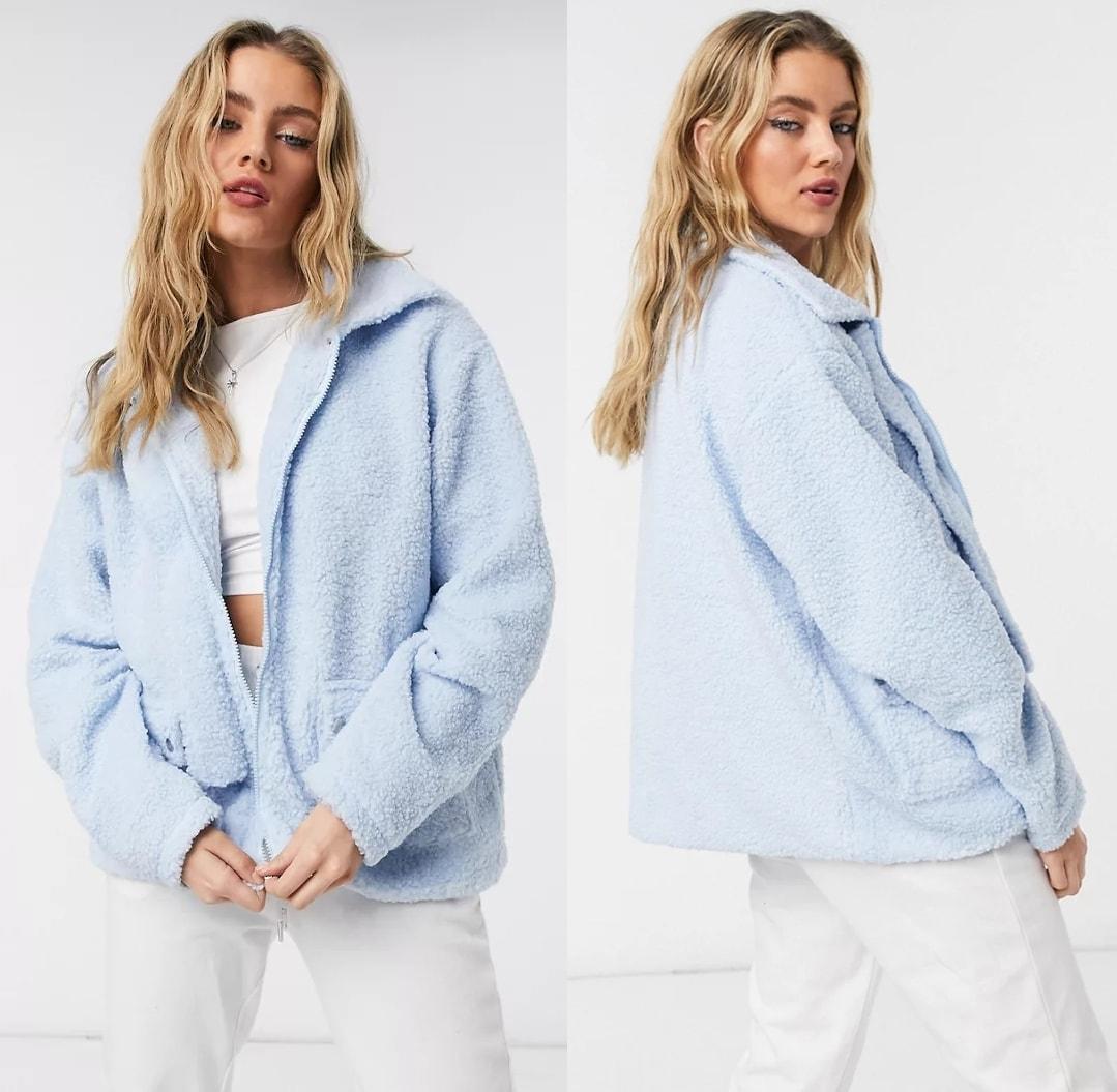 Light blue jacket with pocket detail in teddy fleece